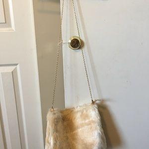 Boohoo Bags - BooHoo cream color faux fur clutch purse 1bcad2e44363f